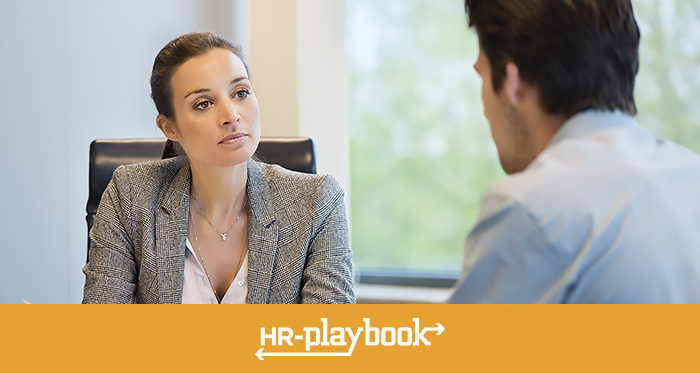 person interviewing with an HR professional
